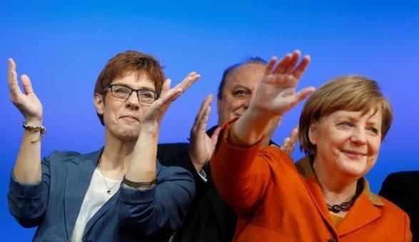 Merkel's CDU wins first strike against Schulz